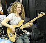 [Pictue of Tal Wilkenfeld playing bass guitar]