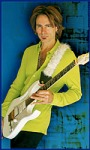 [Picture of Steve Vai playing Jem7]